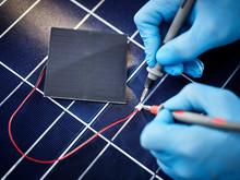 Technician Measuring Resistor Of Silicon Solar Cell