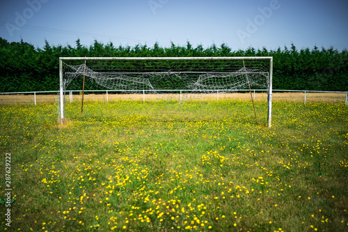 Obraz Abandoned weathered soccer goal on the meadow - fototapety do salonu