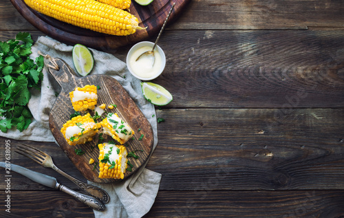 Wallpaper Mural Baked corn cobs with aioli sauce and cilantro
