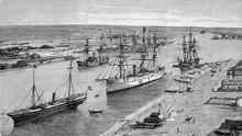 The Suez Canal At Port Said, Egypt. The Canal Joined The Mediterranean And The Red Sea, Reducing Substantially The Navigation Time Between Europe And East Asia