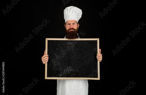 Fotomural Restaurant chef showing menu blackboard sign