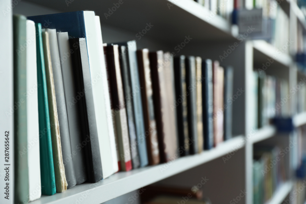 Fototapety, obrazy: Closeup view of shelves with books in library