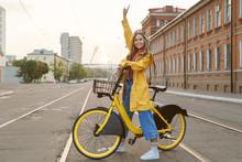Young Woman Wearing Yellow Coa...