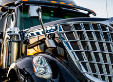 Professional Stylish Black Big Rig Semi Truck Tractor With Shiny Chrome Grille