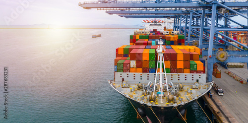 Container cargo freight ship terminal, Aerial view unloading and loading crane of container cargo ship boat at Industrial port with shipping commercial containers , China Wallpaper Mural