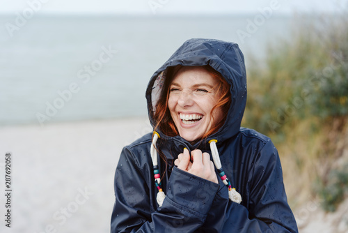 Fotografia, Obraz  Laughing happy woman embracing the cold weather