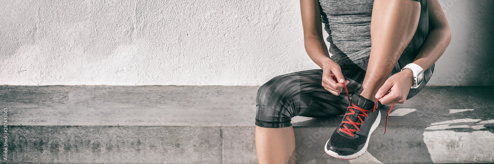 Fototapety, obrazy: Runner athlete woman getting ready to run tying running shoes laces at gym for cardio workout healthy active lifestyle background panorama banner.