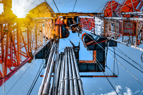 Fototapeta Oil and Gas Drilling Rig. Oil drilling rig operation on the oil platform in oil and gas industry. obraz