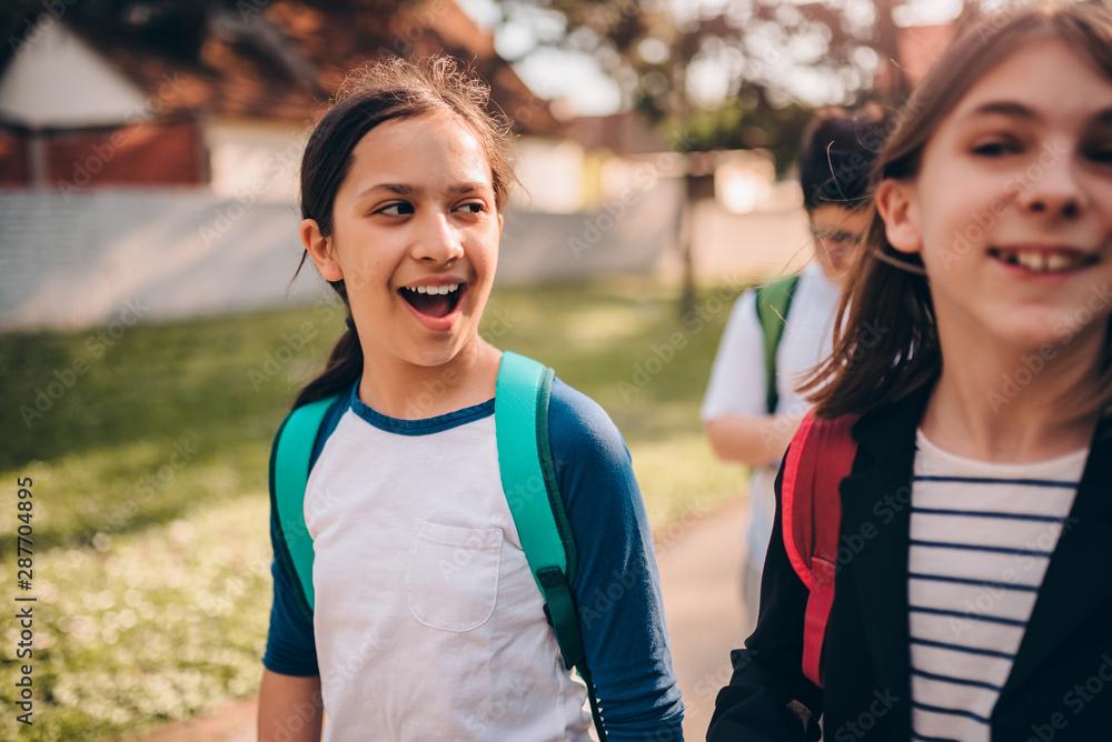 Fototapeta Classmates going home after school