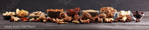 Foto Composition with dried fruits and assorted healthy nuts on rustic background