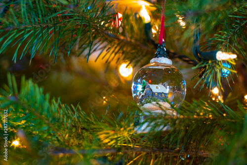 Cuadros en Lienzo Macro photography of Christmas lights and ornaments on a Douglas fir tree