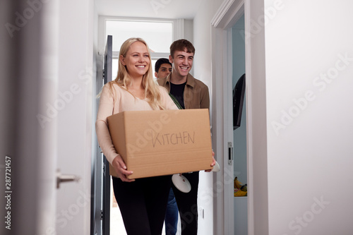 Fotografiet Group Of College Student Carrying Boxes Moving Into Accommodation Together