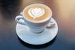 Leinwanddruck Bild - Fresh cappuchino or flat white coffee with latte art close-up