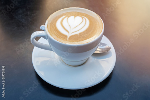 Foto auf Leinwand Natur Fresh cappuchino or flat white coffee with latte art close-up