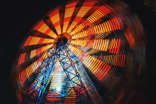 Ferris Wheel At County Fair At Night, Motion Blurred