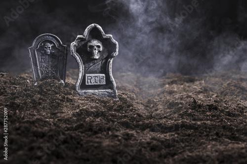 Valokuvatapetti Tombstones on night cemetery in fog
