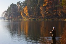 Angler Catching The Fish At Au...