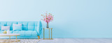 Fototapeta Kwiaty - Living room interior wall mock up with pastel blue sofa, empty blue wall with free space on right 3D render 3D illustration