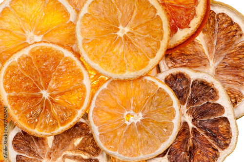 Sliced dried orange pieces against white background Canvas Print