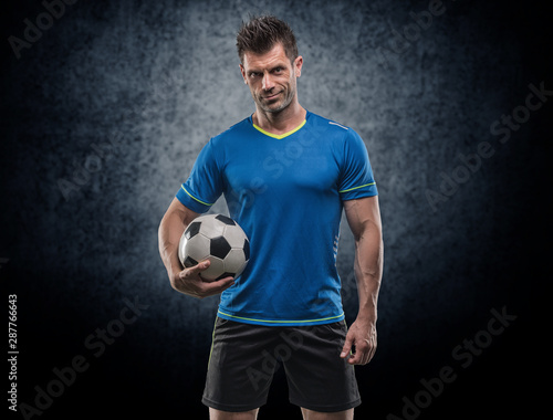 Fotografia Professional football soccer player in action isolated white background