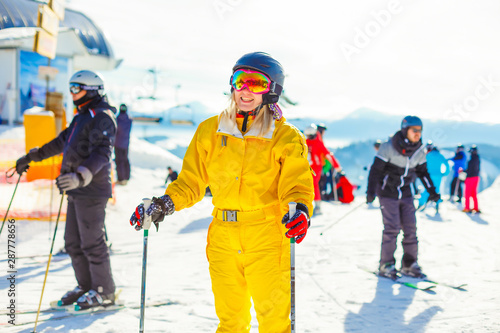 Valokuva  Portrait of blondy young woman with ski in winter time