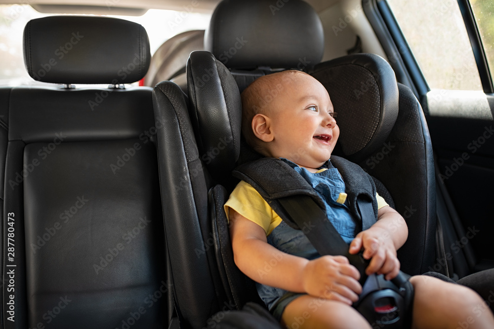 Fototapety, obrazy: Toddler sitting in car during road trip