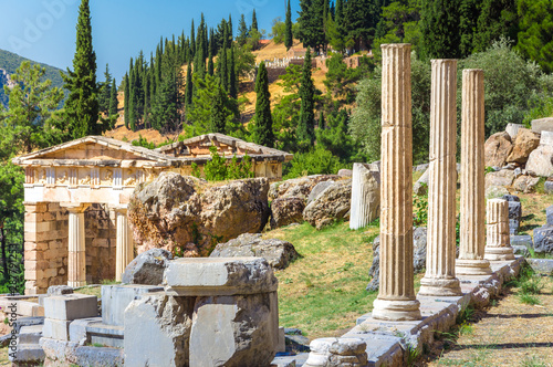 Ancient city of Delphi with ruins of the temple of Apollo, the omfalos (center) Wallpaper Mural