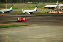 Fire Truck On The Runway Near The Aircraft. Airport Rescue Service. Firefighters And Fire Department At The Airport. Crisis Response System.