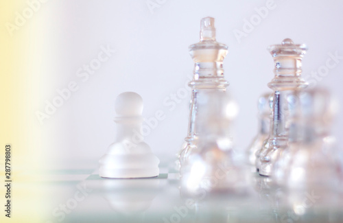 Fotografie, Obraz  One pawn staying against full set of chess pieces