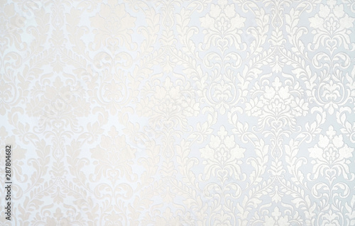 Beautiful texture of paper Wallpaper embossed in form of a classic floral ornament in light golden beige and white tones Slika na platnu