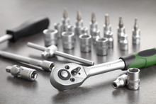 Ratchet Set With Heads, Different Socket Wrenches Close-up On A Dark Stone Background