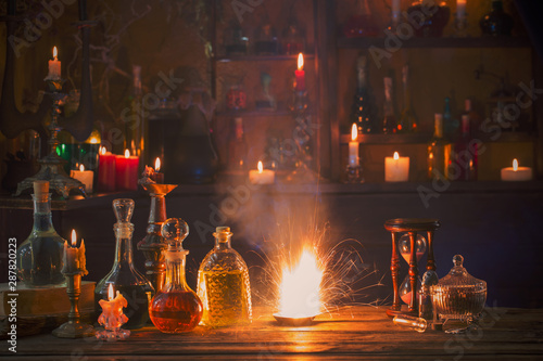 magic potions in bottles on wooden background Wallpaper Mural