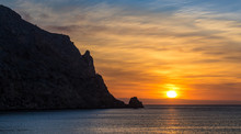 Fantastic Sunrise At Cabo Antonio Near The Spanish City Javea. Exciting Clouds In Orange Shades Decorate The Sky Over The Mediterranean Sea.