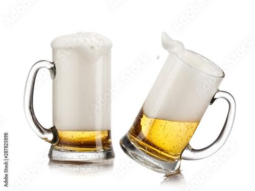Obraz na plátně  Two beer mugs with foam up
