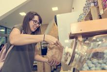 Happy Female Customer Picking ...