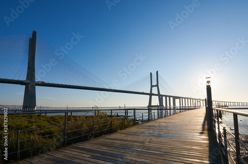 Back-lit shot of Vasco da Gama bridge minutes after sunrise Wallpaper Mural