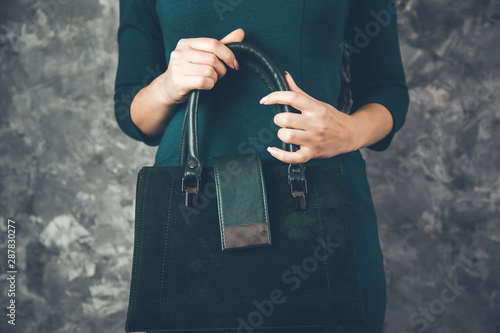 Fotografie, Obraz  young woman hand bag on abstract background