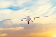 Unmanned Military Drone Patrols The Territory At Sunset. The View Is Straight Ahead.