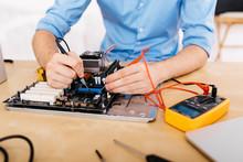 Technician Repairing A Desktop...