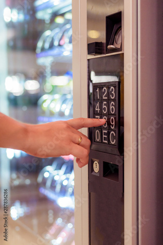 Obraz sell, technology and consumption concept - hand pushing button on vending machine operation panel keyboard - fototapety do salonu