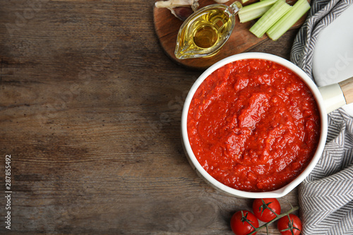 Flat lay composition with pan of tomato sauce on wooden table Wallpaper Mural