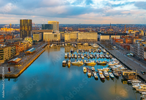 Spoed Foto op Canvas Antwerpen The oldest harbor district of Antwerp city called Eilandje at sunset in use as a yacht marina with waterfront promenade, Antwerp Province, Belgium.