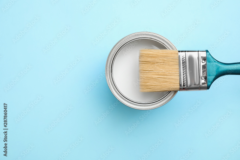 Fototapety, obrazy: Open can with white paint and brush on blue background, top view. Space for text