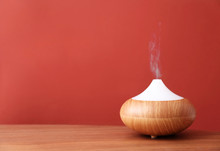 Essential Oils Diffuser On Woo...