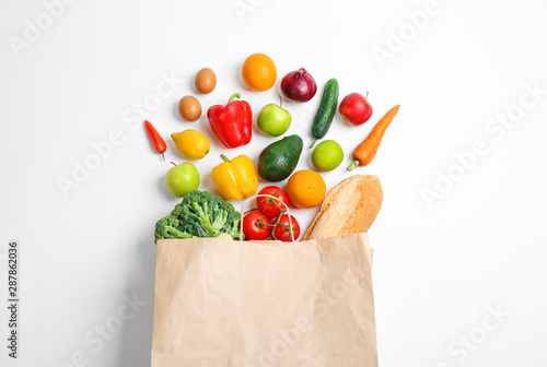 Paper bag with different groceries on white background, top view Wallpaper Mural