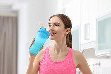 Athletic Young Woman Drinking ...