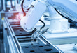 canvas print picture - robotic arm catch for electronic assembly line. The robot for smart technology manufacturing process.