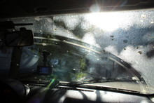 Traces Of Windshield Dirty From Birds Inside