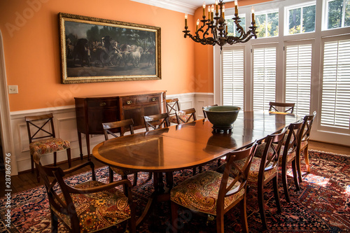 Orange peach colorful dining room with oriental rug and ...
