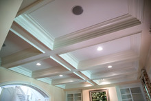 Coffered Ceiling And A Lot Of Natural Light From The Large Windows.
